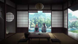 Alto and Sheryl sitting in Japanese room with doors slid open to pond garden