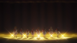 Characters standing on a stage with curtain rising